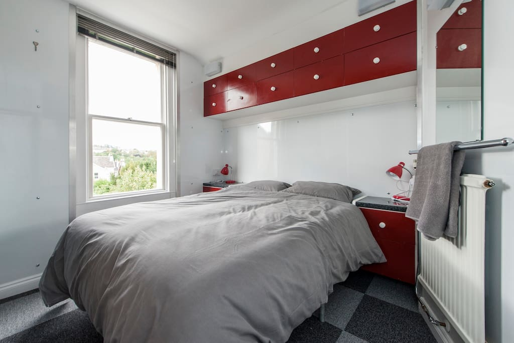 Bedroom arranged with a large double bed