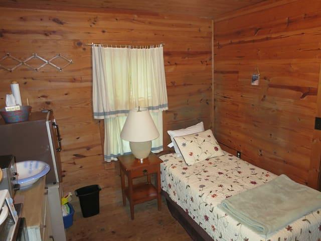 Single bed in back room