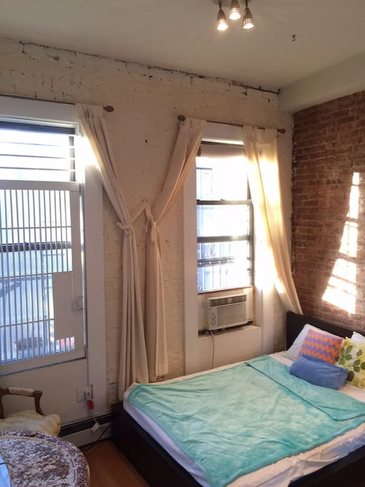Bedroom as is: Furnished - high ceilings, windows & tons of light. Quiet and comfortable.