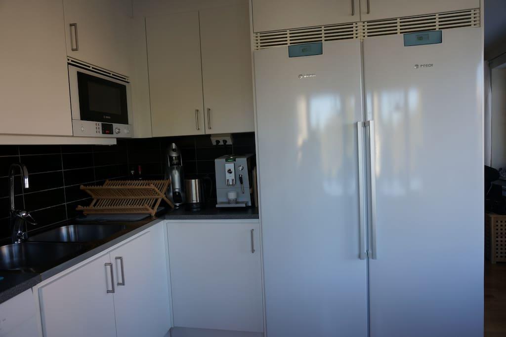 microwave, coffee machine, freezer and fridge