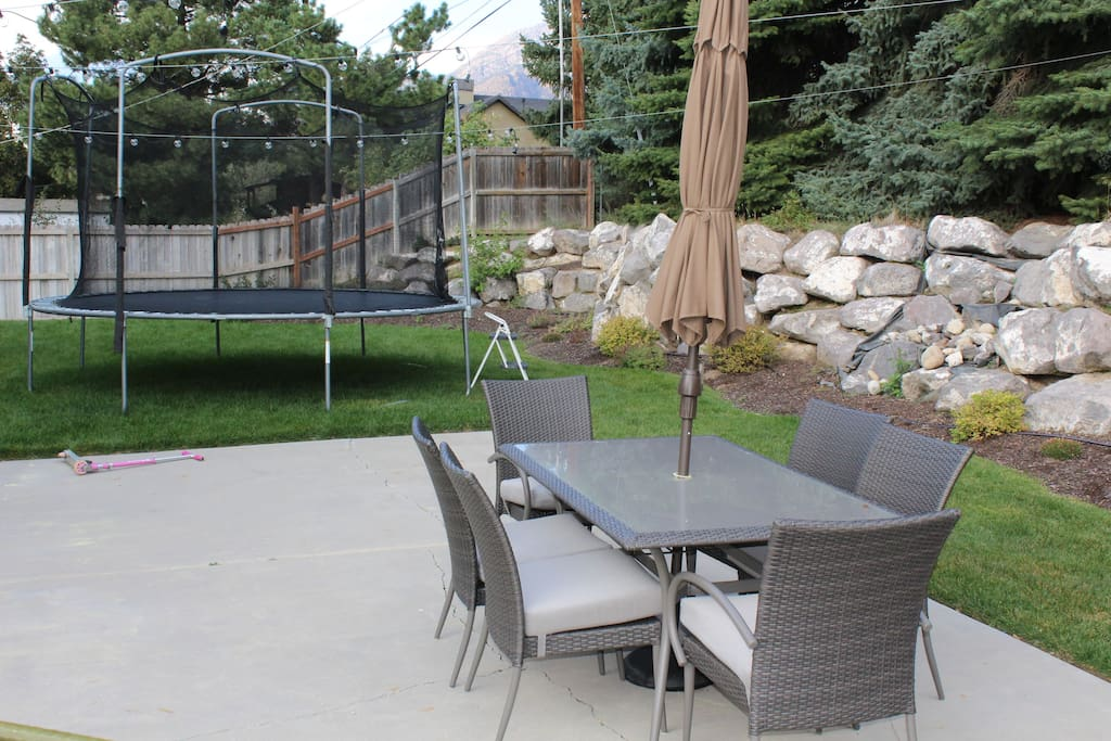 Large patio with BBQ grill.  Plenty of space with trampoline for the kids.
