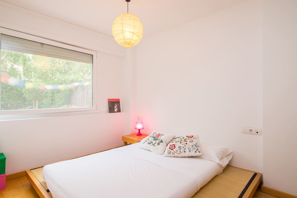 Double bedroom with large window to the garden.