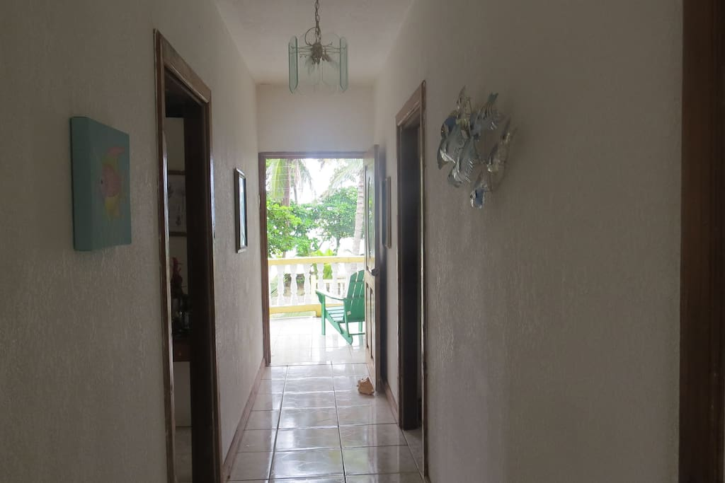 Hallway out to the 2nd story porch. Enjoy the breeze and view of the ocean.