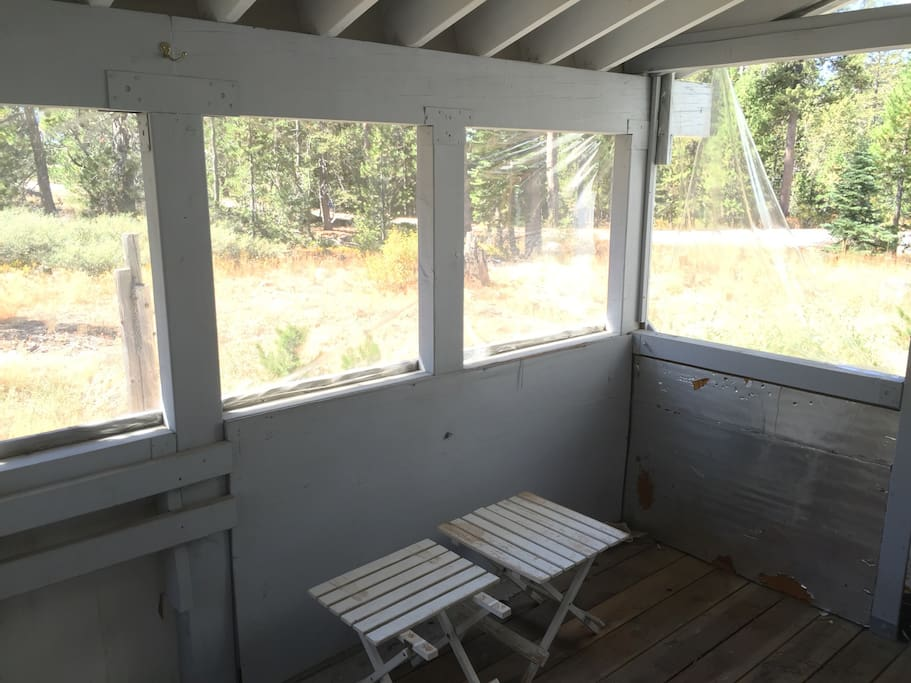 Sun room at the back of the cabin