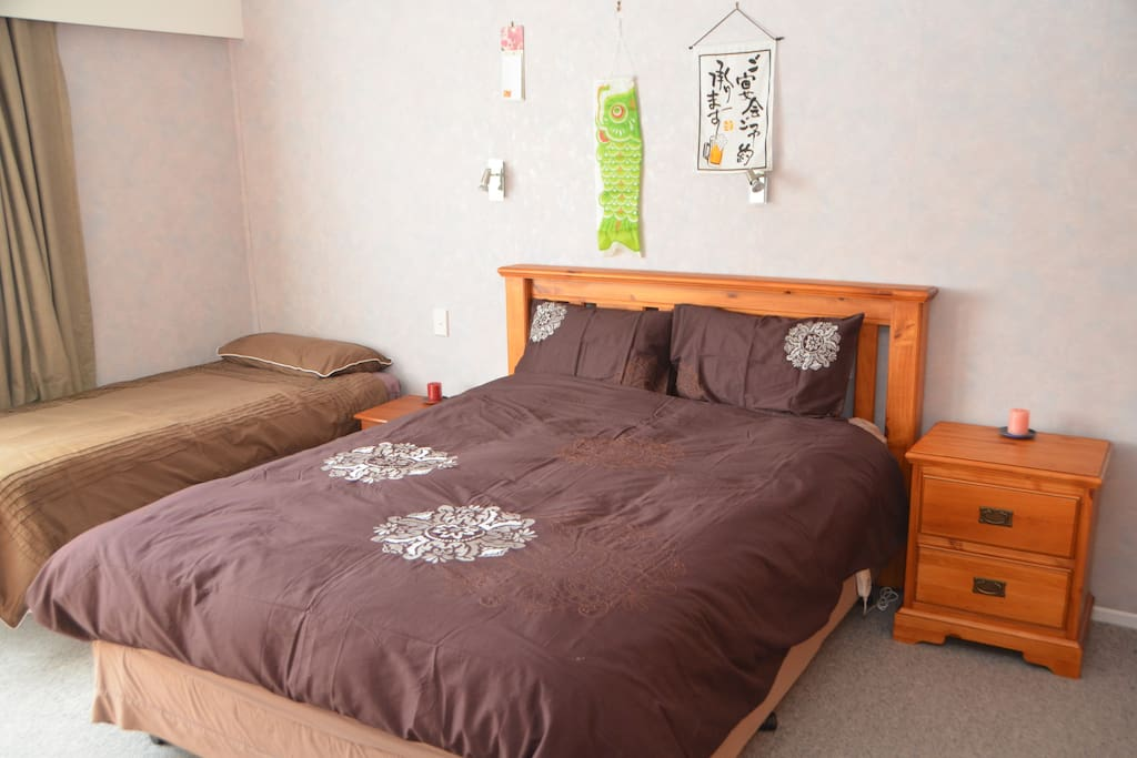 Queen size bed and Single size bed in spacious room