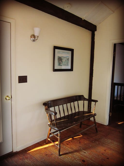 Bench near front door and first bedroom
