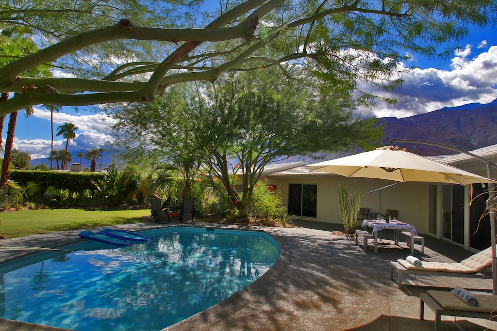 Palm springs bliss with unobstructed mountain views, shade trees cover the pool