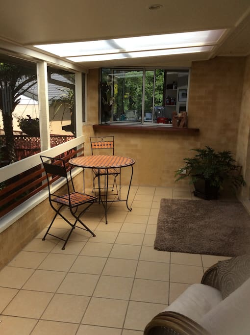 Enclosed verandah for coffee and relaxing.