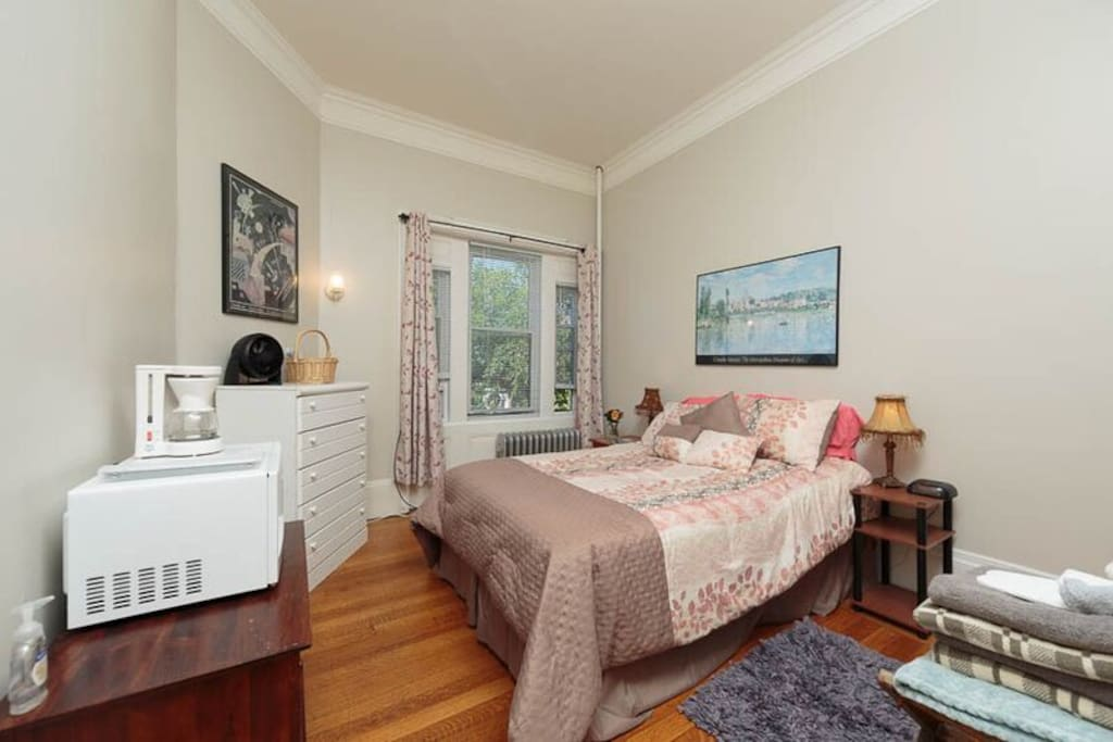 room equipped with fridge, microwave, coffee maker