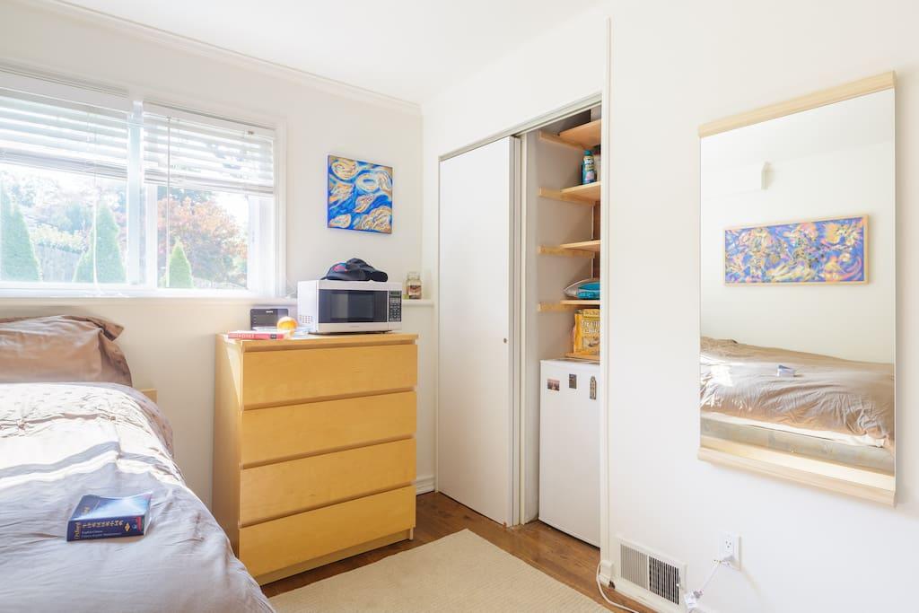 Dresser, closet, microwave and small fridge too.