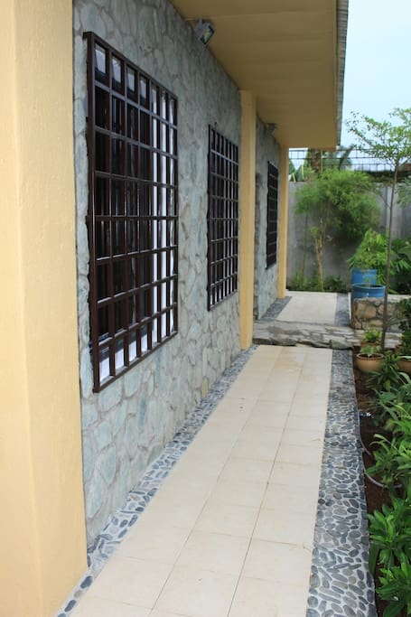 Front of House; Walkway leading to rooms, common area and courtyard
