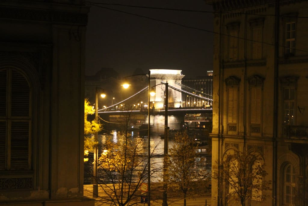 The view from the balcony (Chain Bridge, Gresham Palace and Danube River).