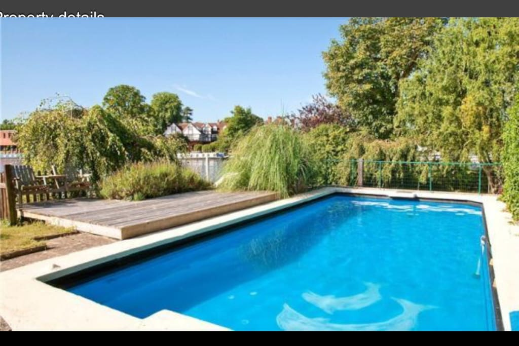 Relax and watch the river go by from your own heated pool