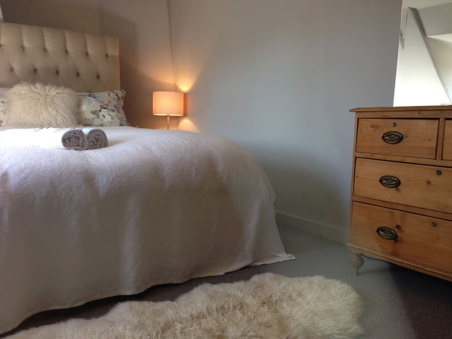 Spacious eaves bedroom with kingsize bed