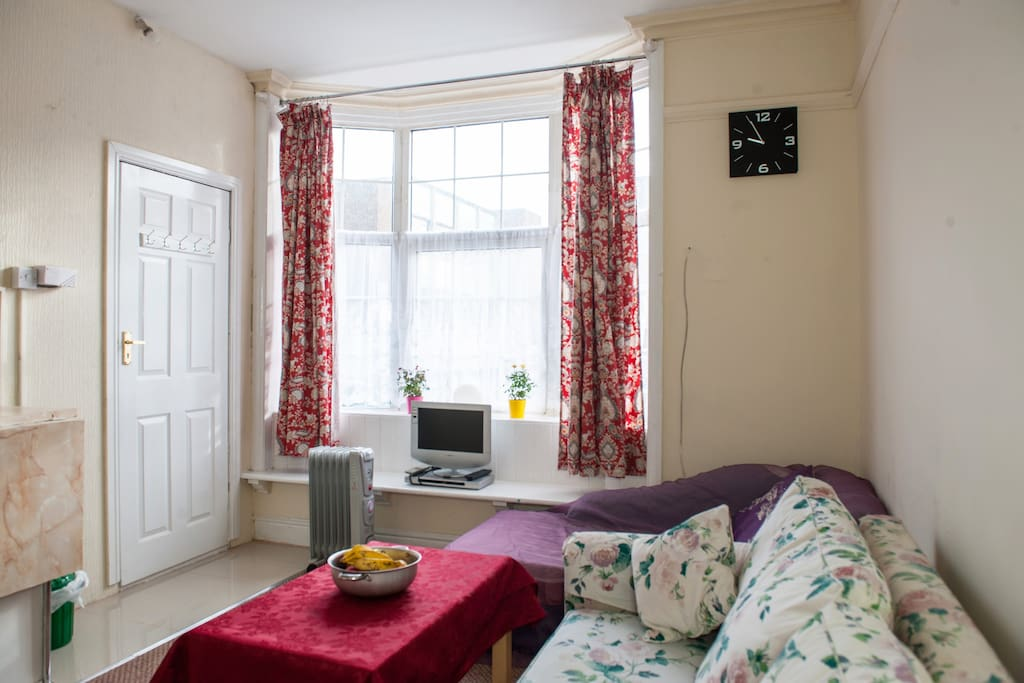 Lounge with bay window and TV., coffee table, settee which turns in to double bed.