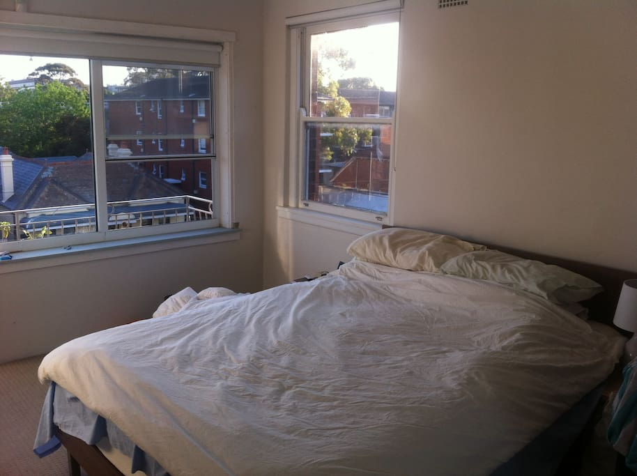 Sunny spacious large master bedroom, with balcony and district views