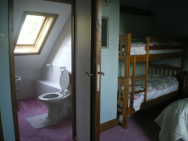 King-size bed and bunk beds. with WC and basin.