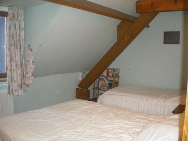 Bedroom 3. King-size and single beds.