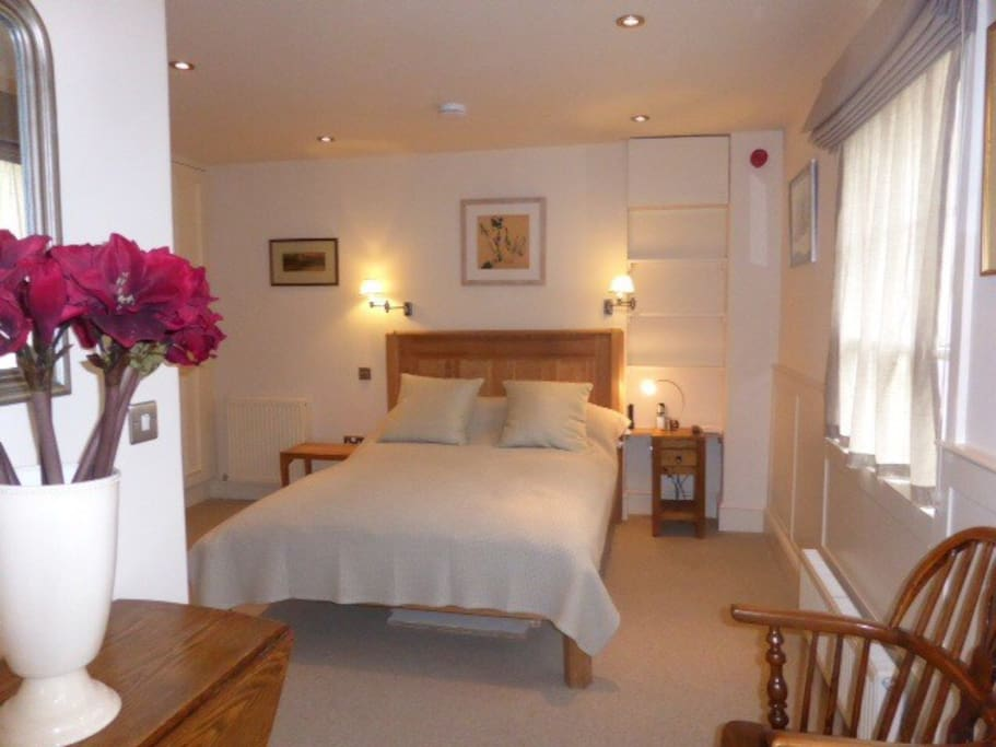 Comfortable double bed made up with quality linen TV. Shower and loo ensuite