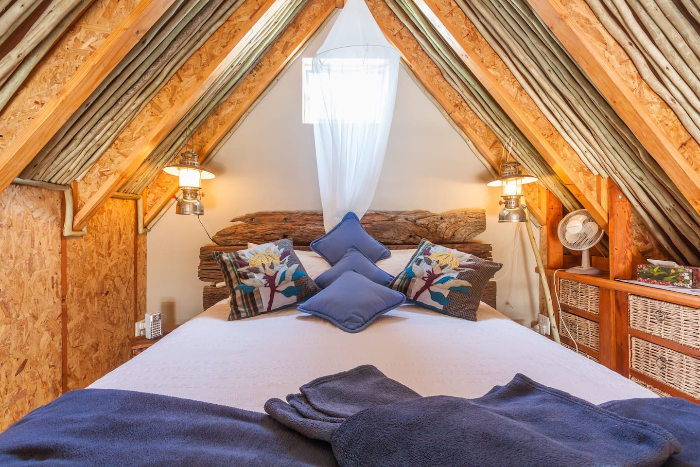 Sleeping loft with double bed and vaulted roof