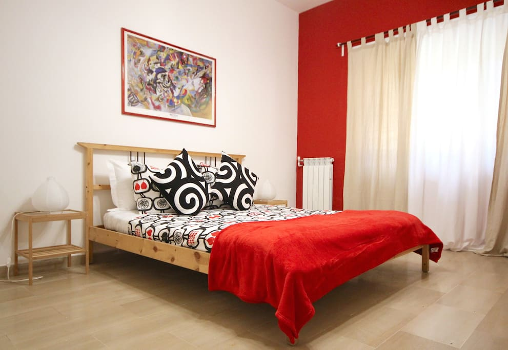 The bed in the red bedroom
