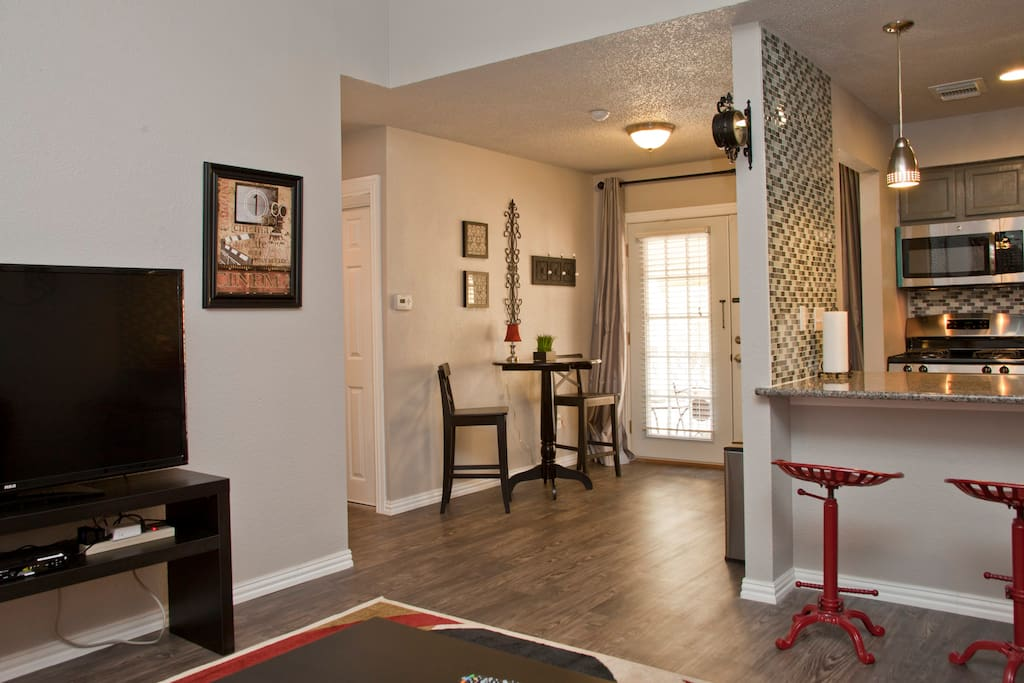 Great open-concept layout from double-French door entrance foyer to kitchen and living
