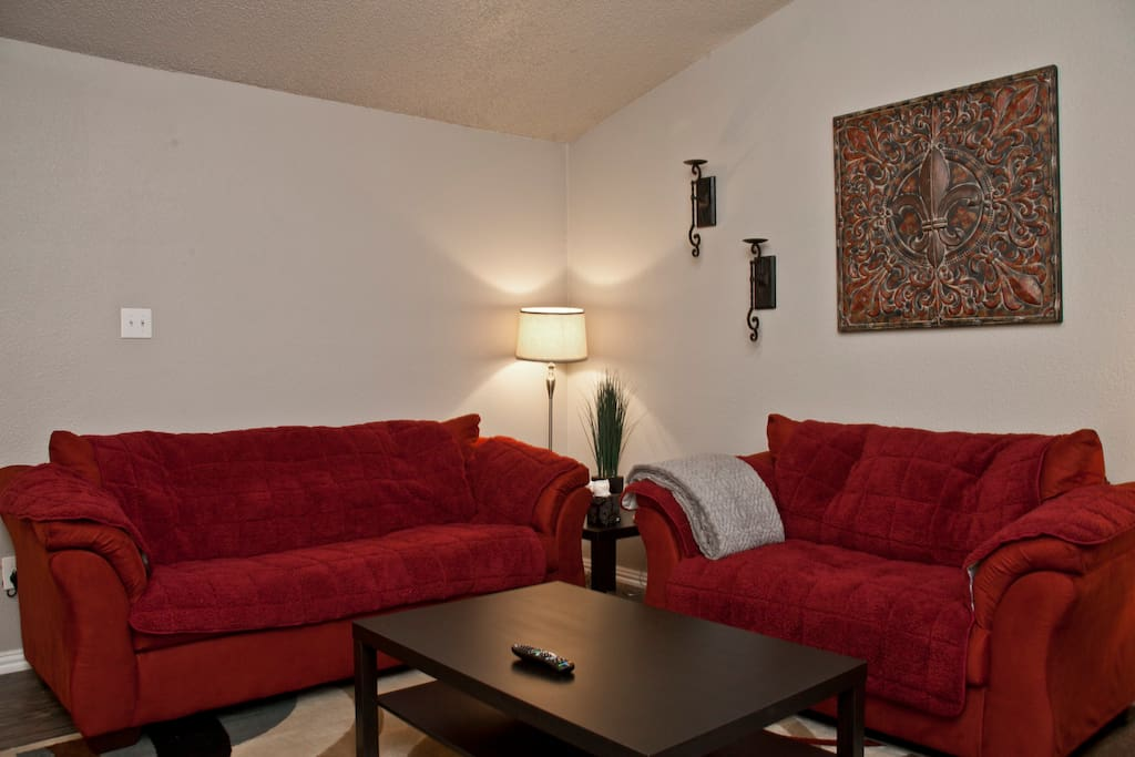 Spacious living area with vaulted ceiling, sofa sleeper and loveseat