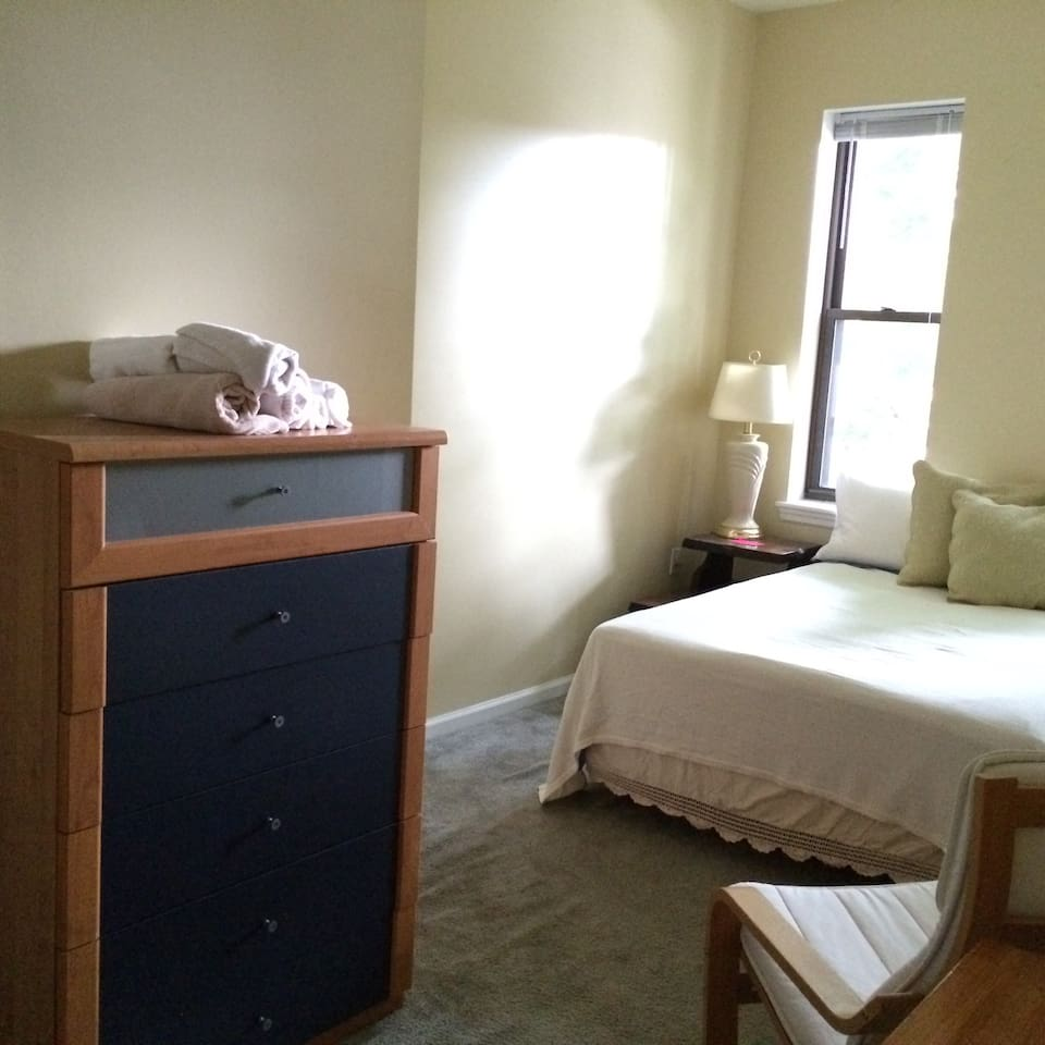 Rear bedroom (second floor).  Double bed, dresser, night stand.  Linens, bedding, towels included.