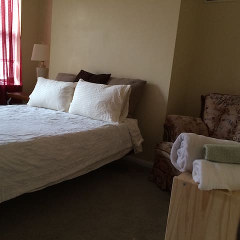 Front bedroom (second floor).  Double futon includes linens, bedding, towels.