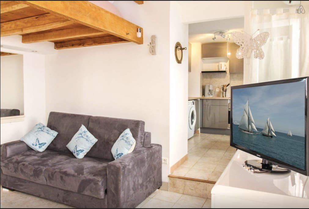 The sitting-room is comfy and is separated to the kitchen area. Television and wifi are amongst the modern comfort that is offered