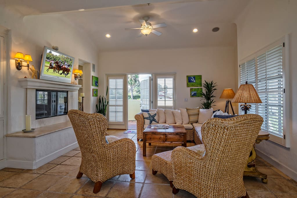 The great room, located on the 3rd level, has a gas fireplace, large plasma TV and DVD player, and a private patio with additional seating.
