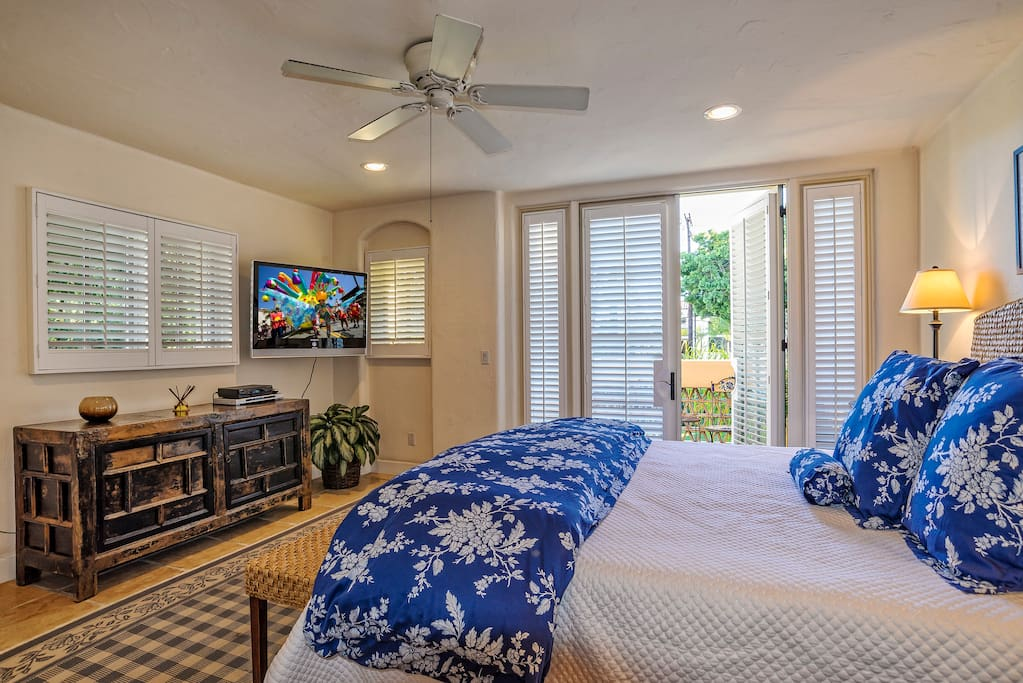 The 2nd level master bedroom #1 has a king bed, luxurious linens, french doors to a private patio, plasma TV and DVD player, tile floors, and an en-suite bathroom
