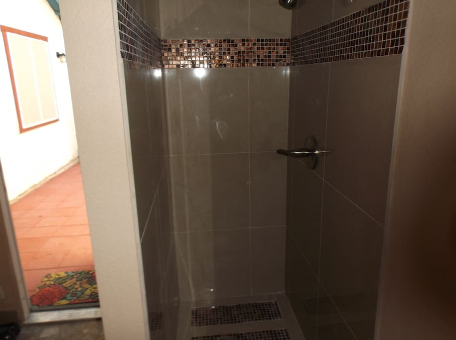 Shower (brand new), soap and shampoo and towels included!