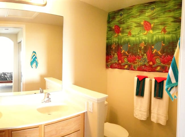 The master bathroom is bright and spacious. With dual sinks - it's ready for two.