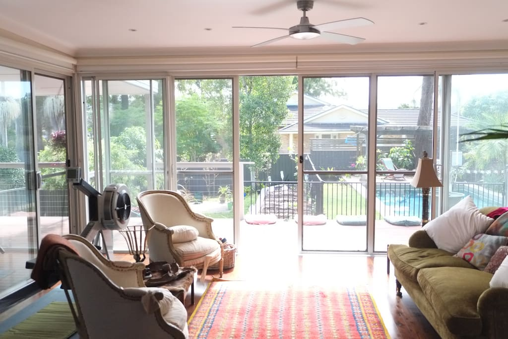 The lounge room opens up onto wide sunny decks and access to the swimming pool