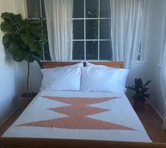 The space is a beautiful, light filled private room with a gorgeous view, (one of the best in the apartment) in a gorgeous 1920's Spanish style building in the heart of Silverlake.