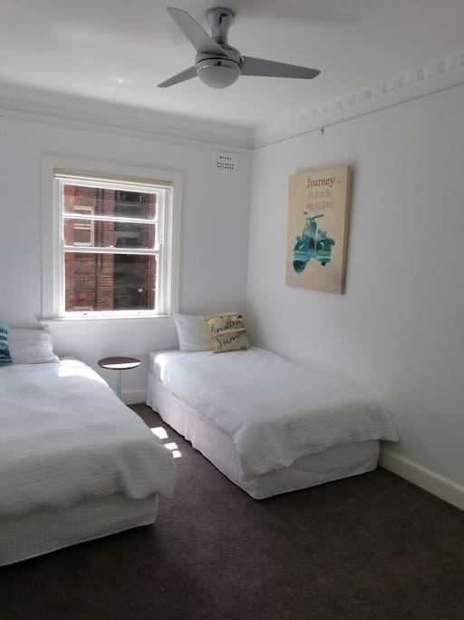 King single / Twin beds with ceiling fan in second bedroom.