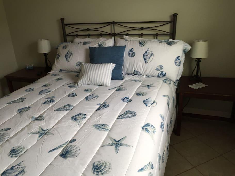 Bedroom 2 with queen size bed.