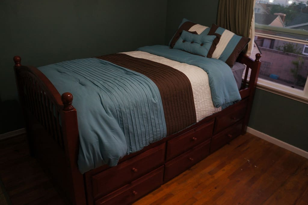 Twin bed with trundle bed put away (trundle slides in/out easily)