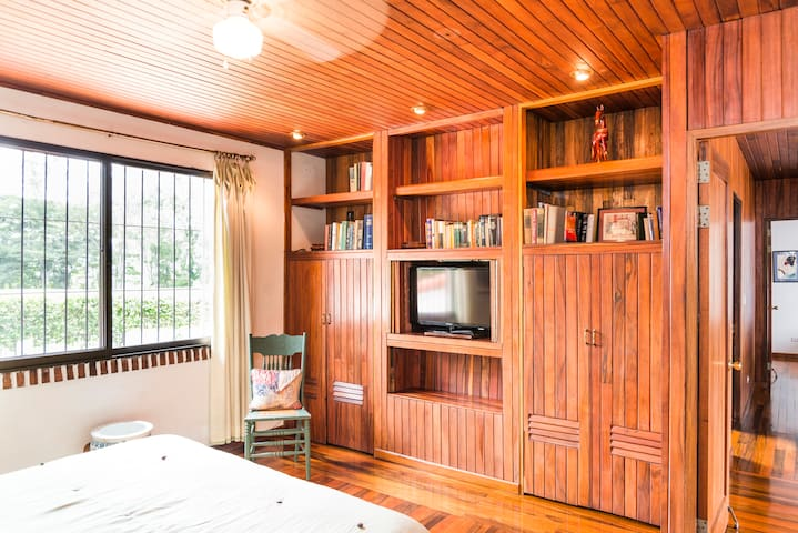 The second Master bedroom has closets galore. Exotic Costa Rican wood, detailing in the second master bedroom with a full en-suite bath