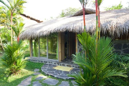 Eco bamboo house in the rice fields. Real Bali.