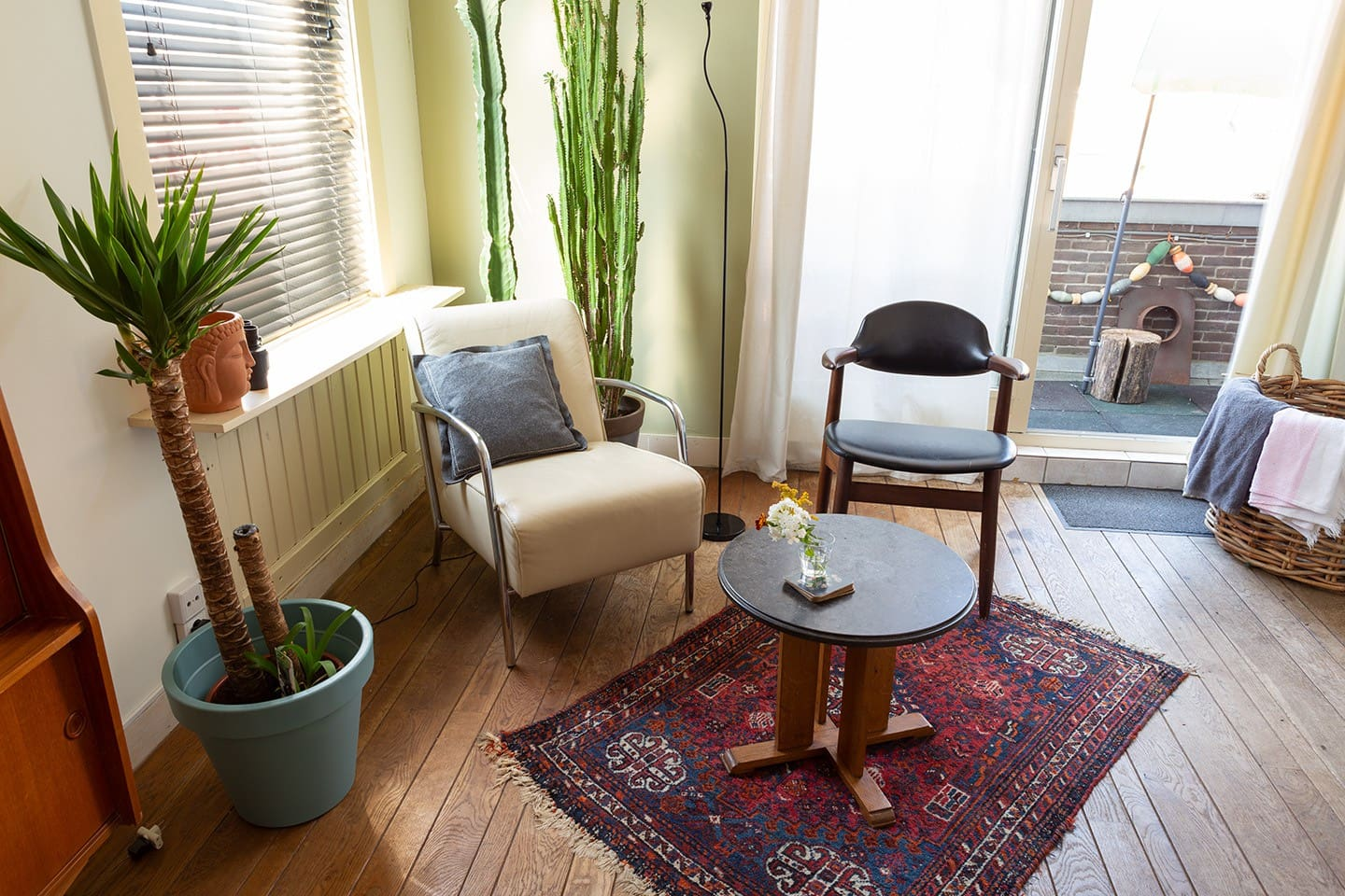 Part of the living area, with entrance to your sunny balcony.