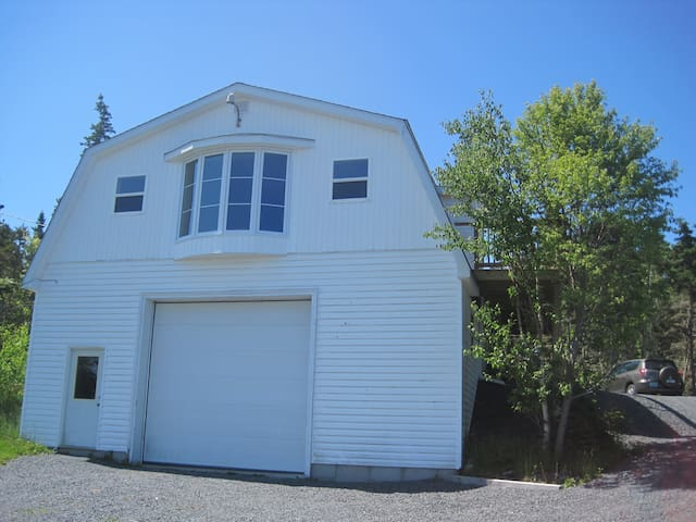 The cottage is the upper level of a boat shed.