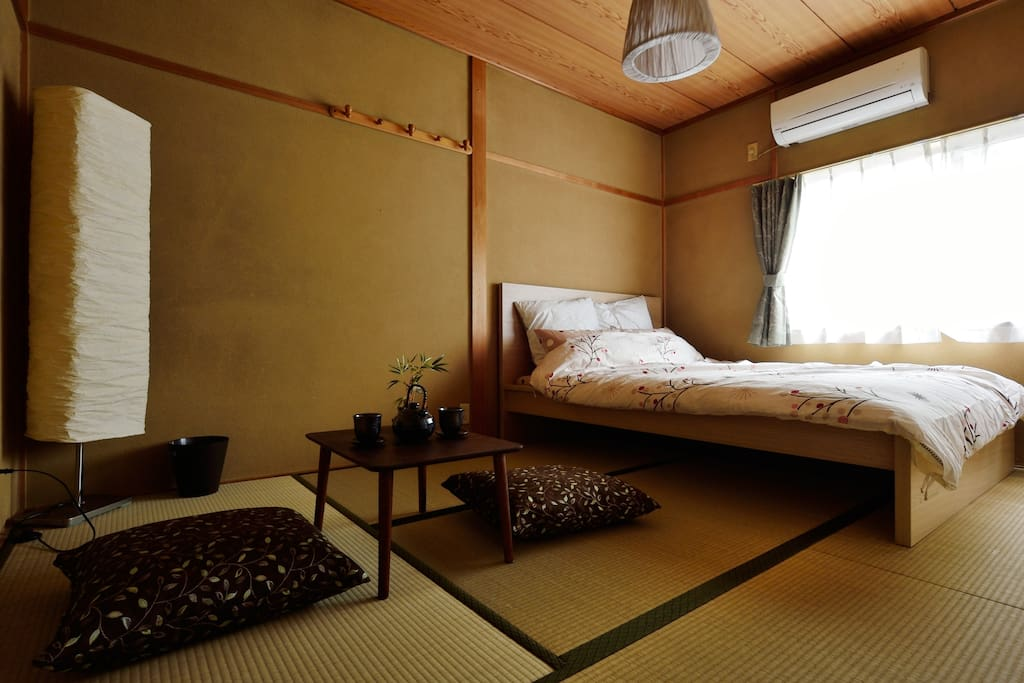 The tatami room with a double bed and Japanese futon for extra guests if needed.