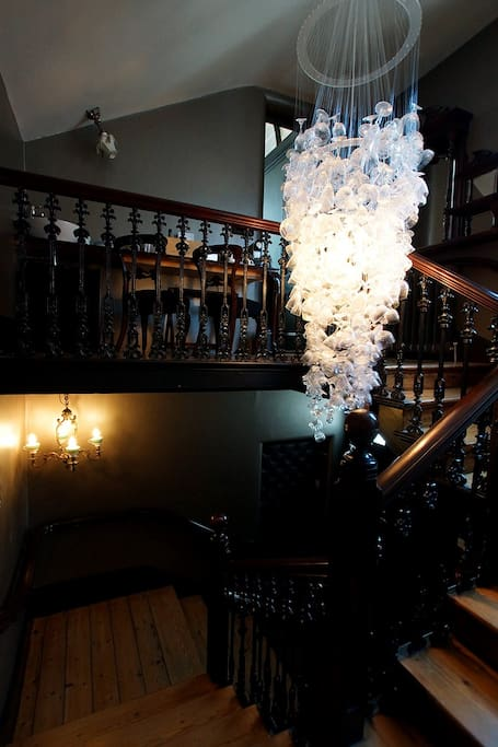 Chandelier hanging in the stairwell of the Chapel Townhouse.