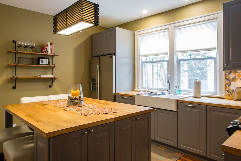 The newly-renovated kitchen is well stocked with anything you'll need to prepare a meal, including utensils, appliances, and even culinary staples. There is serveware for up to twelve, and the island comfortably seats 4 with provided stools.