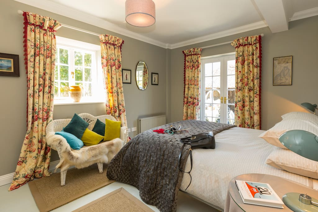 Master double bedroom with french doors to tranquil garden views