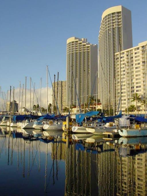 Ilikai Marina on right as it watches the yachts snuggle into harbor