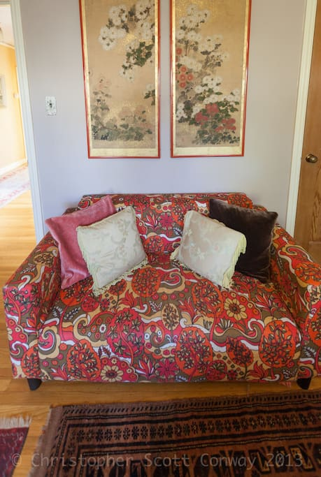 The very cool couch in the room for sitting reading or relaxing.