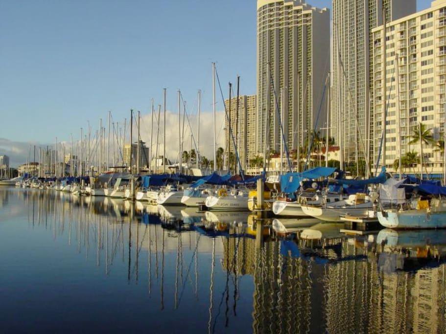 Ilikai Marina on right perfect to watch the yachts snuggle into the harbor